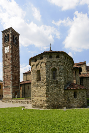 ancient near east: st  Peter church baptistery and bell-tower, Agliate, view from south east of the ancient Romanesque church and its baptistery in Brianza region, near Milan, shot in bright summer light Stock Photo
