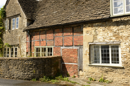 wattle and stone cottages , Lacock, detail of medieval stone and wattle cottages, prospecting on a street in historic touristic village of  Wiltshire Stock Photo