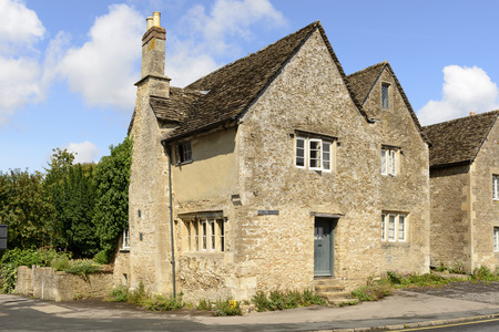 prospecting: old stone cottage, Lacock, medieval stone cottage, prospecting on a street in historic touristic village of  Wiltshire
