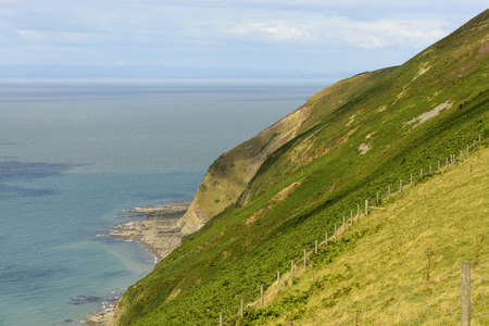 lynmouth: Exmoor coastline near Lynmouth , Devon, view of the moor green coast and of the sea