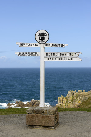 distances: touristic signpost showing the distances from Land End to distant locations Stock Photo