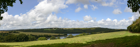 cornwall: Cornwall countryside , landscape of hilly lush Cornwall countryside with river flowing among green fields