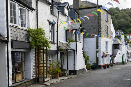 old street at Polperro, Cornwall, cityscape with old houses on a narrow street in the touristic village on southern coast of Cornwall