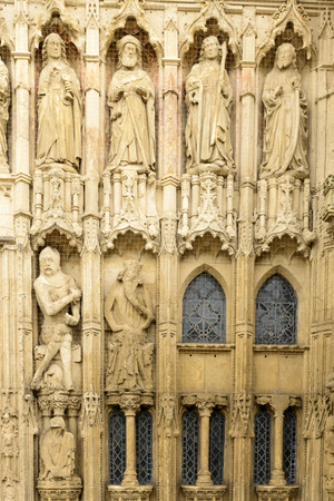 St. Peter Cathedral statues, Exeter, detail of statues on facade of ancient stone church in the historic town of Devon
