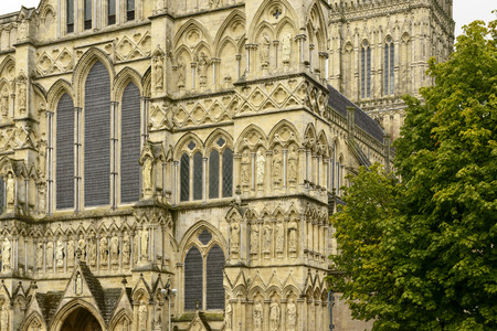 Cathedral facade decoration , Salisbury, detail of highly decorated stone facade of famous Gothic church photo