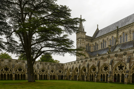 Cathedral and cloister , Salisbury, view of the large cloister alongside the famous Gothic church and of the church itself photo