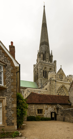west sussex: Cathedral courtyard, Chichester, foreshortening of famous medieval church and service buildings around it, Chichester, West Sussex