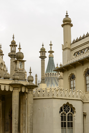 chimneys and pinnacles at Royal Pavillon, Brighton, detail of highly decorated building in center of touristic sea town, shot from the public street,  Brighton, East Sussex