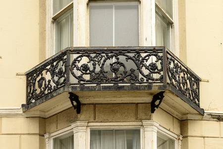cast-iron  railing, Brighton, detail of highly decorated balcony railing made in cast-iron  in center of touristic sea town, shot from the public street,  Brighton, East Sussex
