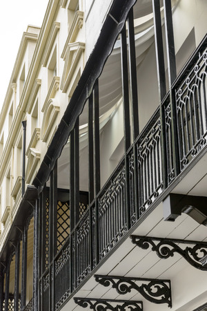 cast-iron balconies, Brighton, detail of balcony railing made in cast-iron  in center of touristic sea town, shot from the public street,  Brighton, East Sussex Stock Photo