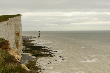 light house at Beachy Head, Eastbourne, landscape of coastline with light house in front of cliffs and beaches at touristic location of Beachy Head, Eastbourne