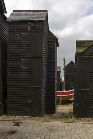 view of old fish net huts built in wood and painted black in historic village of Hastings, East Sussex Stock Photo