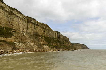 steep cliffs: landscape of coastline with steep cliffs at historic village of Hastings, East Sussex Stock Photo