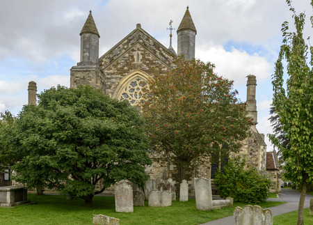 thomas stone: churchyard and St. Thomas curch, view of ancient  stone church and its cemetery in small  historic village of Rye, East Sussex