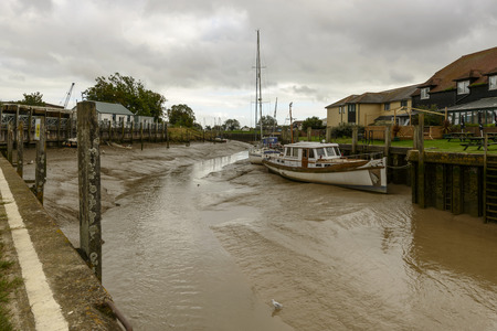 view of boats aground at low tide at river harbour of the historic village of Rye, East Sussex Stock Photo