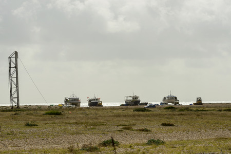 shingle: view of  old fish boats aground on the shingle beach at Dungedness,  Romney Marsh, Kent