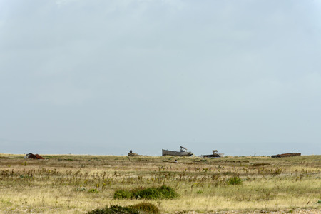 view of  wrecks of old fish boats on the seaside at Dungedness,  Romney Marsh, Kent Stock Photo