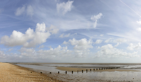 kent: view, at low tide time, of the sea and the shingle beach at New Romney, Kent Stock Photo