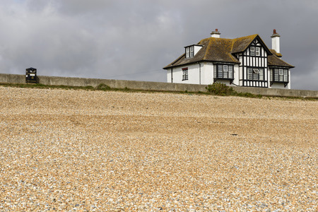 kent: landscape of the beach with old holiday cottage near the seaside at New Romney, Kent