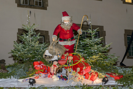 Santa Klaus and gifts on stall roof of traditional Christmas market hold in city center, shot on dec 01 2014 , Stuttgart, Germany
