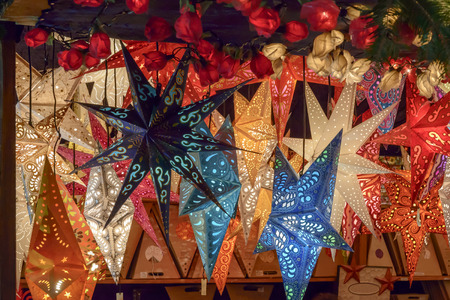 star lights at Xmas market time 03, detail of lightened stars in stall at traditional Christmas market hold in city center, shot on dec 02 2014 , Stuttgart, Germany