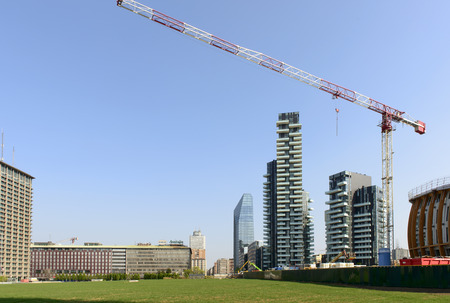 prospecting: MILAN, ITALY - APRIL 11: view of the building site of cranes and tall buildings at prospecting business hub on the wheat field prepared for EXPO 2015 in city center, shot on april 11, 20154 Milan, Italy