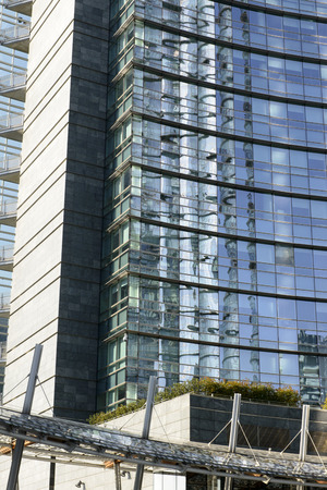 foreshortening: foreshortening of glass reflections on building facades at new business hub in the city center, Milan, Italy