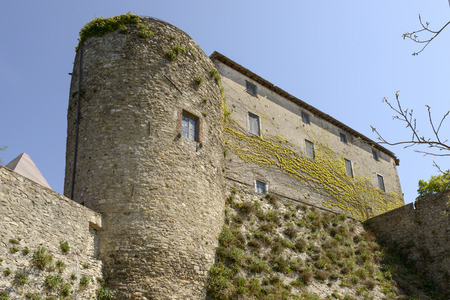 dungeons: Malaspina castle huge wall view of high walls and round dungeon of ancient Castle shot on a sunny spring day Fosdinovo Italy Editorial