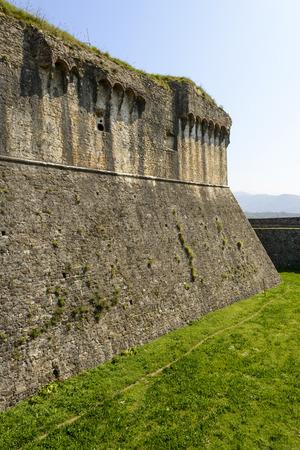 sarzana: Sarzanello fortress walls view of stone walls of ancient Castle dry moat shot on a sunny spring day Sarzana Italy Editorial