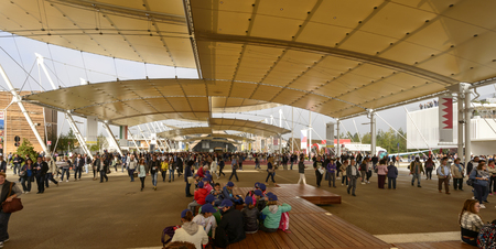 tensile: MILAN, ITALY - October 07, EXPO 2015, a crowd of visitors walks under the tensile membrane structure over the main walk, shot on oct 07 2015 Milan, Italy