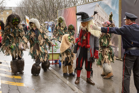 STUTTGART, GERMANY - FEBRUARY 09: a group of sylvan masks in the parade under light rain. Shot at Carnival parade in the city center on February 9, 2016 Stuttgart, Germany Editorial