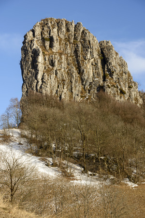 upland: steep rocky cliff in Lecco mountains in a winter with little snow, shot in bright winter light at Resinelli upland, Italy Stock Photo
