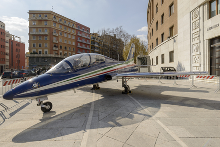 seater: MILAN, ITALY - MARCH 17: military jet trainer on temporary display in front of Air Force building in the town center as advertisment for aviation exhibition. Shot in bright light on march 17, 2016 Milan, Italy Editorial