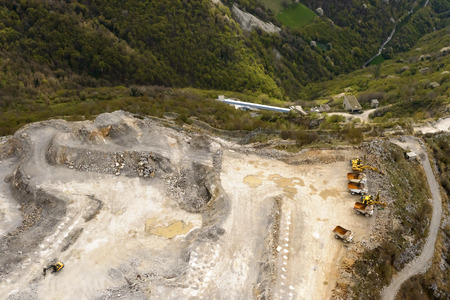 diggers: aerial landscape, from a small plane, of diggers and trucks at rest in a stone quarry, Albenza shot at mountain in Orobie, Bergamo, Italy