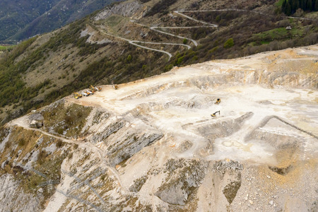 diggers: aerial landscape, from a small plane, of a stone quarry with diggers and trucks at rest, shot at Albenza mountain in Orobie, Bergamo, Italy