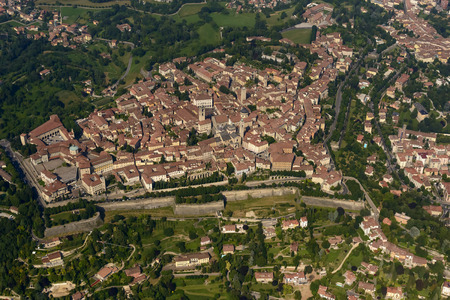 small plane: aerial shot, from a small plane, of city-walls and buildings of old high town of Bergamo, Lombardy, Italy Stock Photo