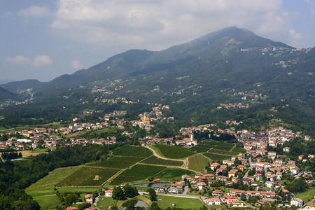 aerial shot, from a small plane, of Almenno village, shot in the Orobie mountains, Bergamo, Lombardy, Italy