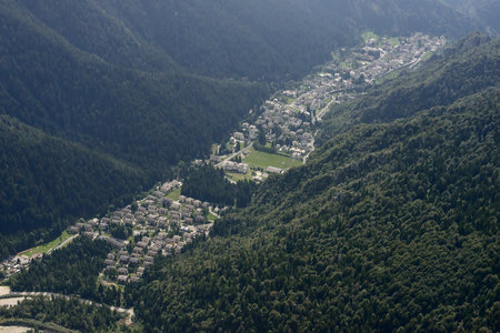 small plane: aerial shot, from a small plane, Piazzatorre village of Brembana valley, shot in the Orobie mountains, Bergamo, Lombardy, Italy Stock Photo