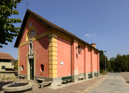 facade and side view of ancient small church of San Rocco in Sasello village, inland Ligure, Italy