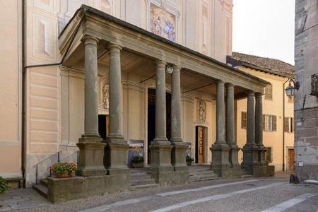 view of arcade in front of ancient church of St. John the Baptist church in Sasello village, inland Ligure, Italy