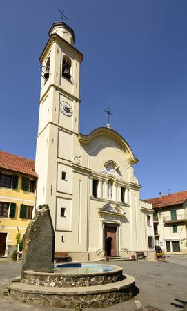 facade of ancient church of San Pietro in Olba village, inland Ligure, Italy
