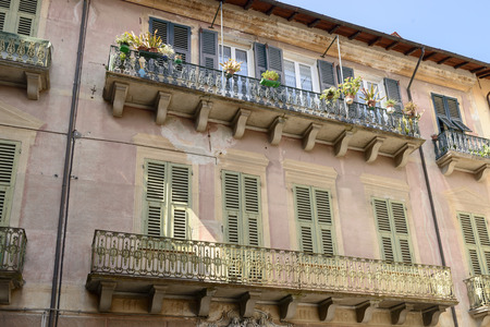detail of iron railings on balconies of old house in the village of Sassello, inland Ligure, Italy