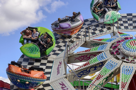 perinola: STUTTGART, GERMANY - OCTOBER 02: detail of fast running whirligig. Shot at Oktoberfest in city center on oct 02, 2016 Stuttgart, Germany