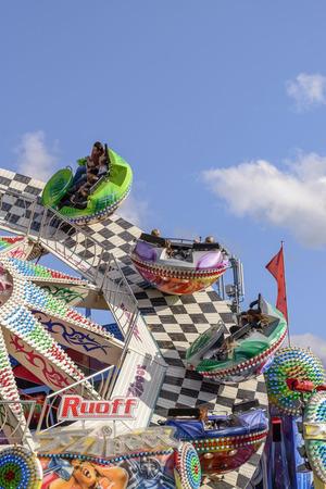 molinete: STUTTGART, GERMANY - OCTOBER 02: colored bowls of fast running whirligig. Shot at Oktoberfest in city center on oct 02, 2016 Stuttgart, Germany