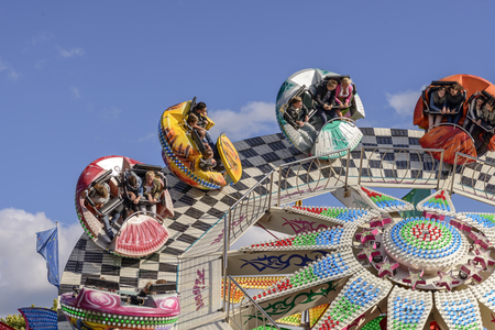 STUTTGART, GERMANY - OCTOBER 02: People spinned on the fast running whirligig. Shot at Oktoberfest in city center on oct 02, 2016 Stuttgart, Germany Editorial