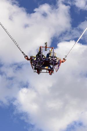 STUTTGART, GERMANY - OCTOBER 02: frightening bungee revolutions in carnival. Shot at Oktoberfest in city center on oct 02, 2016 Stuttgart, Germany