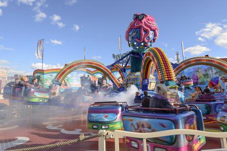 wheeling: STUTTGART, GERMANY - OCTOBER 02: foreshortening of white steam into wheeling octopus whirligig in carnival. Shot at Oktoberfest in city center on oct 02, 2016 Stuttgart, Germany Editorial