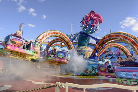 STUTTGART, GERMANY - OCTOBER 02: foreshortening of white vapor in wheeling octopus whirligig in carnival. Shot at Oktoberfest in city center on oct 02, 2016 Stuttgart, Germany Editorial