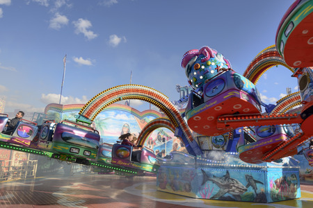 STUTTGART, GERMANY - OCTOBER 02: foreshortening of high speed steam in cabs among wheeling octopus whirligig in carnival. Shot at Oktoberfest in city center on oct 02, 2016 Stuttgart, Germany