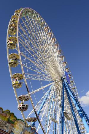 wheeling: STUTTGART, GERMANY - OCTOBER 02: foreshortening of big iron ferris wheel at carnival. Shot at Oktoberfest in city center on oct 02, 2016 Stuttgart, Germany Editorial